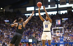 Kansas guard Ochai Agbaji (30) puts up a three over Oklahoma State forward Cameron McGriff (12) during the first half, Saturday, Feb. 9, 2019 at Allen Fieldhouse.