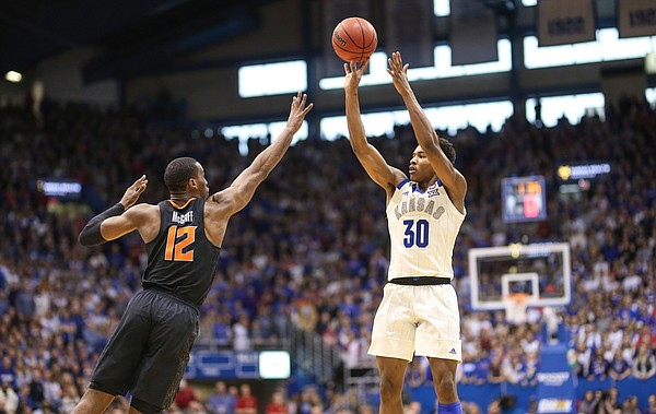 Kansas guard Ochai Agbaji (30) puts up a 3 over Oklahoma State forward Cameron McGriff (12) during the first half, Saturday, Feb. 9, 2019 at Allen Fieldhouse.