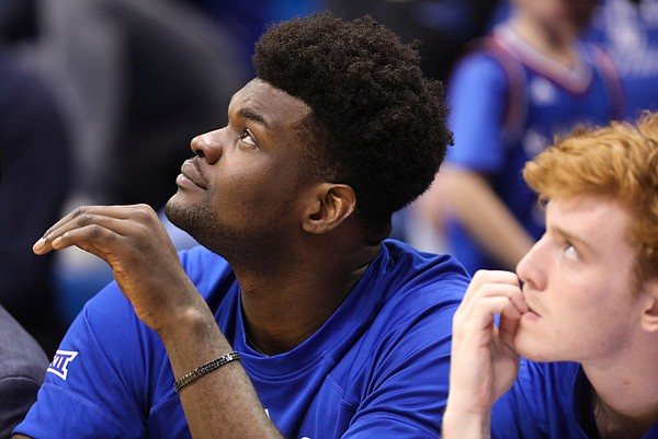 Injured center Udoka Azubuike (35) watches from the bench during the second half, Saturday, Feb. 16, 2019 at Allen Fieldhouse.