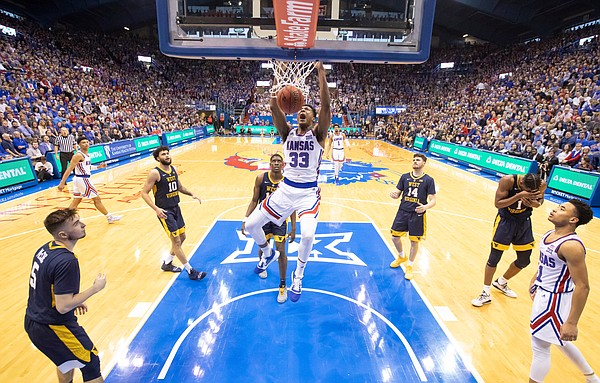 Kansas forward David McCormack (33) roars as he dunks late in the second half against West Virginia, Saturday, Feb. 16, 2019 at Allen Fieldhouse.