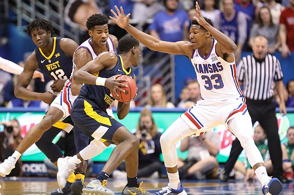 Kansas guard Ochai Agbaji (30) and Kansas forward David McCormack (33) defend against a drive by West Virginia forward Lamont West (15) during the first half, Saturday, Feb. 16, 2019 at Allen Fieldhouse.