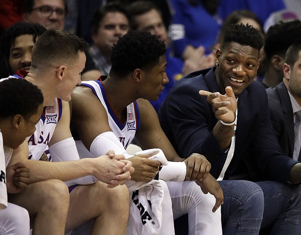 Kansas forward Silvio De Sousa, right, points to teammates during the second half of an NCAA college basketball game against Texas Tech in Lawrence, Kan., Saturday, Feb. 2, 2019. Kansas defeated Texas Tech 79-63. (AP Photo/Orlin Wagner)