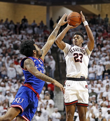 Texas Tech's Jarrett Culver (23) shoots over Kansas' K.J. Lawson (13) during the second half of an NCAA college basketball game Saturday, Feb. 23, 2019, in Lubbock, Texas. (AP Photo/Brad Tollefson)