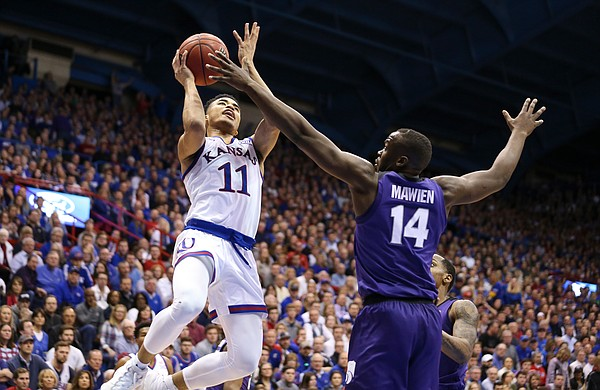 Kansas guard Devon Dotson (11) pulls up for a shot over Kansas State forward Makol Mawien (14) during the second half, Monday, Feb. 25, 2019 at Allen Fieldhouse.
