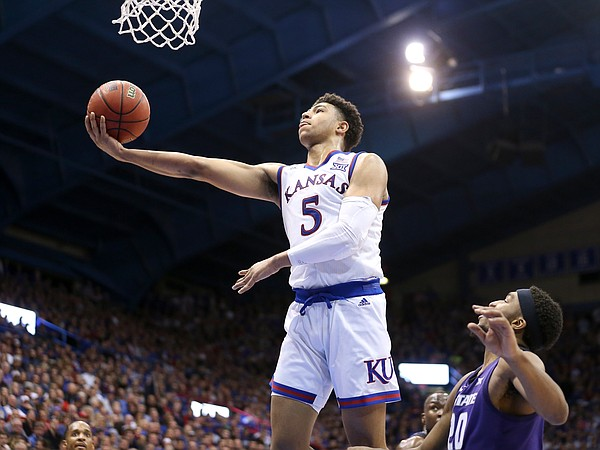 Kansas guard Quentin Grimes (5) swoops in for a bucket past Kansas State forward Xavier Sneed (20) during the second half, Monday, Feb. 25, 2019 at Allen Fieldhouse.