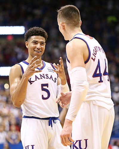 Kansas guard Quentin Grimes (5) and Kansas forward Mitch Lightfoot (44) celebrate with little time remaining during the second half, Monday, Feb. 25, 2019 at Allen Fieldhouse.