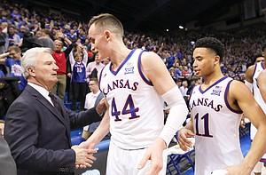 Kansas State head coach Bruce Weber congratulates Kansas forward Mitch Lightfoot (44) and Kansas guard Devon Dotson (11) following the Jayhawks' win on Monday, Feb. 25, 2019 at Allen Fieldhouse.