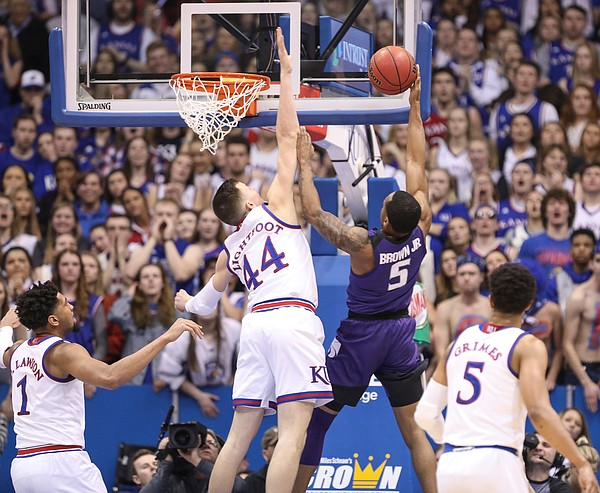 Kansas forward Mitch Lightfoot (44) gets up to block a shot from Kansas State guard Barry Brown Jr. (5) during the first half, Monday, Feb. 25, 2019 at Allen Fieldhouse.
