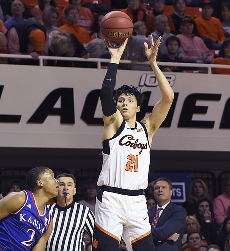 Kansas forward Charlie Moore, left, watches as Oklahoma State guard Lindy Waters III takes a shot during an NCAA college basketball game in Stillwater, Okla., Saturday, March 3, 2019. (AP Photo/Brody Schmidt)