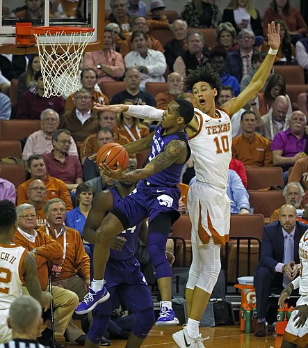 Kansas State guard Barry Brown, Jr., left, drives to the basket against Texas forward Jaxson Hayes during the first half of an NCAA college basketball game, Tuesday, Feb. 12, 2019, in Austin, Texas. (AP Photo/Michael Thomas)