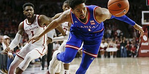 Kansas forward Dedric Lawson (1) tries to save the ball from going out of bounds in front of Oklahoma guards Rashard Odomes (1), back left, and Christian James (0) in the first half of an NCAA college basketball game in Norman, Okla., Tuesday, March 5, 2019. (AP Photo/Nate Billings)