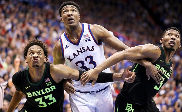 Kansas forward David McCormack (33) muscles for position with Baylor forward Freddie Gillespie (33) and Baylor guard King McClure (3) during the second half, Saturday, March 9, 2019 at Allen Fieldhouse.