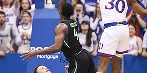 Kansas forward Mitch Lightfoot (44) is called for a blocking foul as Baylor guard Mario Kegler (4) puts up a shot during the first half, Saturday, March 9, 2019 at Allen Fieldhouse. Also pictured is Kansas guard Ochai Agbaji (30).