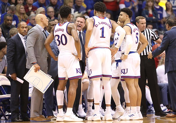 Kansas head coach Bill Self talks with the Jayhawks during a timeout in the first half, Saturday, March 9, 2019 at Allen Fieldhouse.