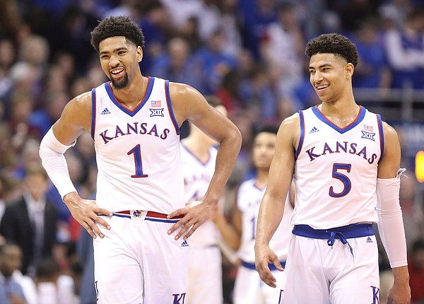 Kansas forward Dedric Lawson (1) and Kansas guard Quentin Grimes (5) have a laugh during a timeout in the first half, Saturday, March 9, 2019 at Allen Fieldhouse.