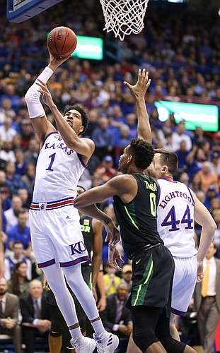 Kansas forward Dedric Lawson (1) puts in a bucket over Baylor forward Flo Thamba (0) during the first half, Saturday, March 9, 2019 at Allen Fieldhouse.