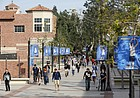 In this Feb. 26, 2015, file photo, students walk on the University of California, Los Angeles campus. (AP Photo/Damian Dovarganes, File)
