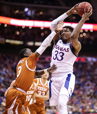 Kansas forward David McCormack (33) pulls a rebound from Texas guard Courtney Ramey (3) during the first half, Thursday, March 14, 2019 at Sprint Center in Kansas City, Mo.