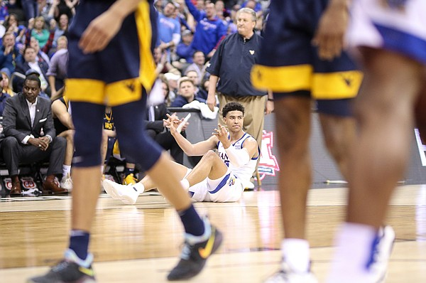 Kansas guard Quentin Grimes (5) signals three after being fouled on a made three-point attempt during the first half, Friday, March 15, 2019 at Sprint Center in Kansas City, Mo.