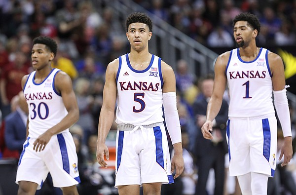 Kansas guard Quentin Grimes (5), Kansas guard Ochai Agbaji (30) and Kansas forward Dedric Lawson (1) walk back onto the court after a timeout during a run by the Cyclones in the first half, Saturday, March 16, 2019 at Sprint Center in Kansas City, Mo.