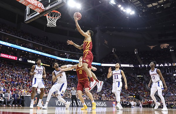 Iowa State guard Nick Weiler-Babb (1) gets in for a bucket as the Jayhawks watch during the second half, Saturday, March 16, 2019 at Sprint Center in Kansas City, Mo.
