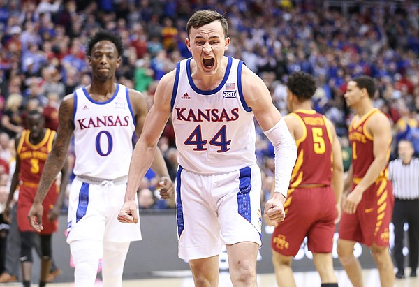 Kansas forward Mitch Lightfoot (44) celebrates a bucket and an Iowa State foul on Kansas guard Quentin Grimes (5) during the first half, Saturday, March 16, 2019 at Sprint Center in Kansas City, Mo.