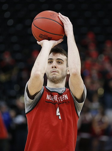 Northeastern guard Vasa Pusica shoots during practice at the NCAA men's college basketball tournament Wednesday, March 20, 2019, in Salt Lake City. (AP Photo/Rick Bowmer)