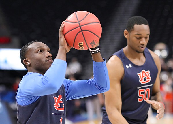 Auburn guard Jared Harper (1) puts up a shot on Wednesday, March 20, 2019 at Vivint Smart Home Arena in Salt Lake City, Utah. Teams practiced and gave interviews to media members before Thursday's opening round games.