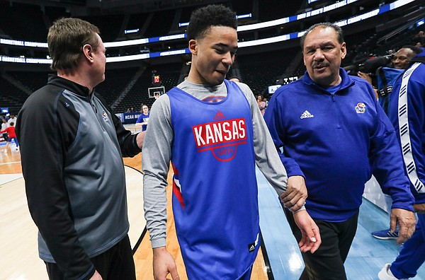 Kansas guard Devon Dotson (11) walks off the court with Kansas head coach Bill Self, left, and assistant coach Kurtis Townsend on Wednesday, March 20, 2019 at Vivint Smart Home Arena in Salt Lake City, Utah. Teams practiced and gave interviews to media members before Thursday's opening round games.