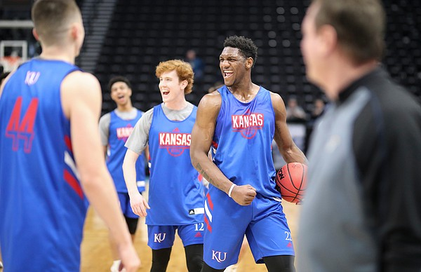 Kansas forward Silvio De Sousa and Kansas guard Chris Teahan (12) celebrate a dunk by a teammate as practice wraps up on Wednesday, March 20, 2019 at Vivint Smart Home Arena in Salt Lake City, Utah. Teams practiced and gave interviews to media members before Thursday's opening round games.