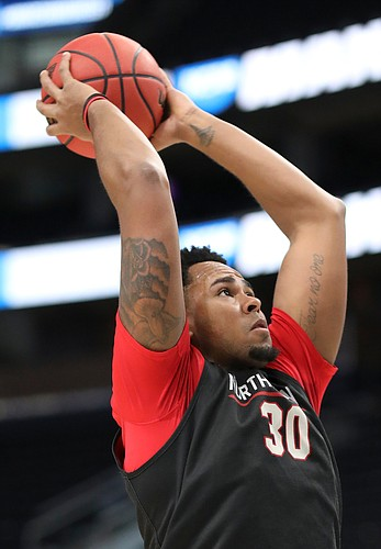 Northeastern center Anthony Green (30) pulls back to dunk on Wednesday, March 20, 2019 at Vivint Smart Home Arena in Salt Lake City, Utah. Teams practiced and gave interviews to media members before Thursday's opening round games.