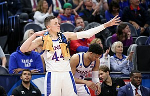 Kansas forward Mitch Lightfoot (44) lets an arrow fly after a three-pointer by teammate Devon Dotson during the second half, Thursday, March 21, 2019 at Vivint Smart Homes Arena in Salt Lake City, Utah.