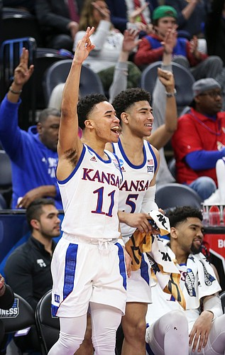 Kansas guard Devon Dotson (11), Kansas guard Quentin Grimes (5) and Kansas forward Dedric Lawson (1) celebrate a late three-pointer from Kansas forward Mitch Lightfoot during the second half, Thursday, March 21, 2019 at Vivint Smart Homes Arena in Salt Lake City, Utah.