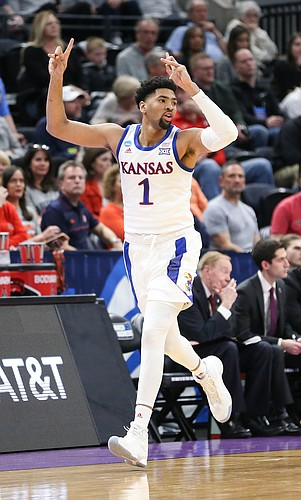 Kansas forward Dedric Lawson (1) celebrates after hitting a three during the first half, Thursday, March 21, 2019 at Vivint Smart Homes Arena in Salt Lake City, Utah.