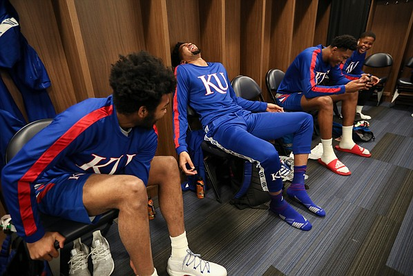 Kansas forward Dedric Lawson falls back into his locker while laughing with his brother K.J. Lawson on Friday, March 22, 2019 at Vivint Smart Homes Arena in Salt Lake City, Utah.