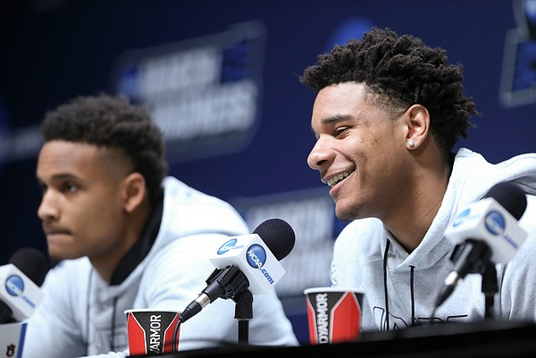 Auburn forward Chuma Okeke smiles as he talks about growing up playing basketball with Kansas forward Dedric Lawson during a press conference on Friday, March 22, 2019 at Vivint Smart Homes Arena in Salt Lake City, Utah. At left is Auburn guard Bryce Brown.