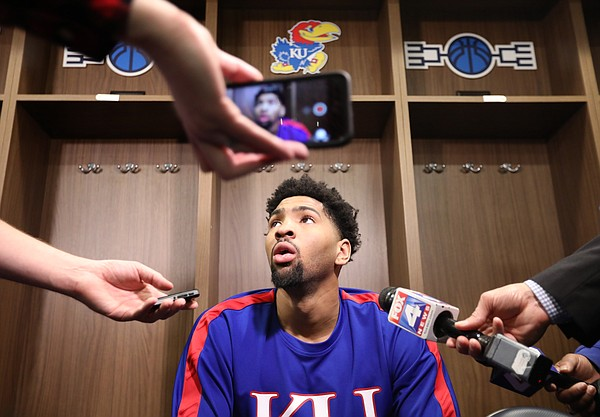 Kansas forward Dedric Lawson (1) takes questions from media members in the team locker room on Friday, March 22, 2019 at Vivint Smart Homes Arena in Salt Lake City, Utah.