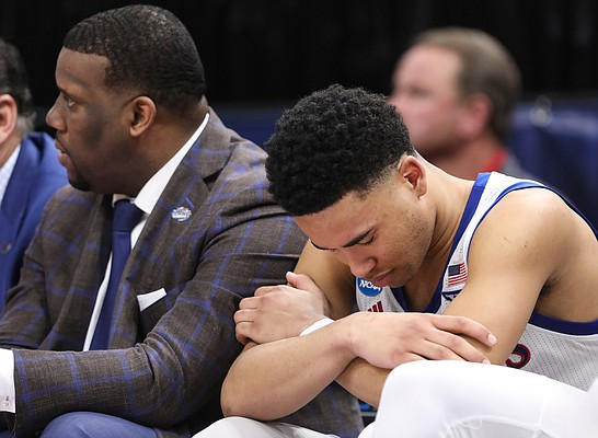 Kansas guard Devon Dotson (11) hangs his head on the bench after fouling out during the second half on Saturday, March 23, 2019 at Vivint Smart Homes Arena in Salt Lake City, Utah.