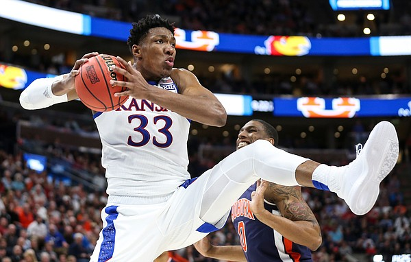 Kansas forward David McCormack (33) pulls away an offensive rebound from Auburn guard Samir Doughty (10) during the second half on Saturday, March 23, 2019 at Vivint Smart Homes Arena in Salt Lake City, Utah.