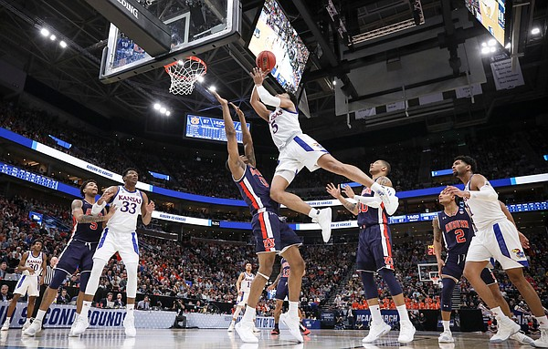 Kansas guard Quentin Grimes (5) gets up for a bucket and a blocking foul on Auburn forward Horace Spencer (0) during the second half on Saturday, March 23, 2019 at Vivint Smart Homes Arena in Salt Lake City, Utah.