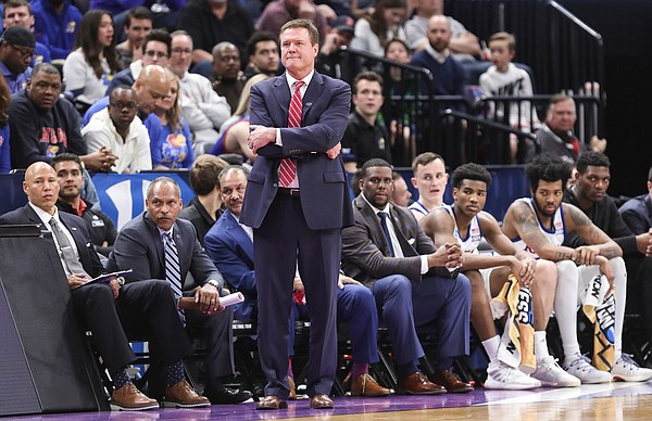 Kansas head coach Bill Self and the bench watch in silence during the first half on Saturday, March 23, 2019 at Vivint Smart Homes Arena in Salt Lake City, Utah.