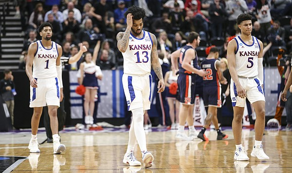Kansas guard K.J. Lawson (13), Kansas forward Dedric Lawson (1) and Kansas guard Quentin Grimes (5) leave the court as the buzzer sounds the end of the game on Saturday, March 23, 2019 at Vivint Smart Homes Arena in Salt Lake City, Utah.