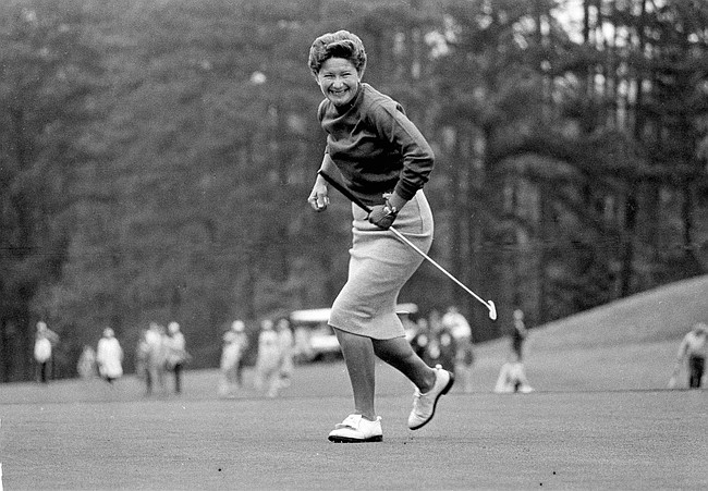 Marilynn Smith watches her ball hang on rim of cup, stomps the ground as ball finally drops, at Augusta, Ga., during the Women's Titleholders Golf Tourney, April 27, 1964. (AP Photo/Horace Cort)