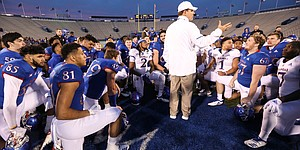 Kansas head coach Les Miles talks with his players after Late Night Under the Lights on Saturday, April, 13, 2019 at Memorial Stadium.