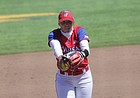 Kansas sophomore pitcher Hannah Todd winds up to throw in a game against Oklahoma, April 14, 2019, at Arrocha Ballpark.