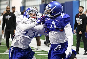 Kansas cornerback Hasan Defense (3) works for position against receiver Andrew Parchment as they compete for a throw to the end zone on Thursday, April 4, 2019 at the indoor practice facility.