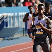Kyle Clemons, a Kansas track and field alumnus and US Olympic Gold Medalist finishes first in the 400 meter dash at the Kansas Relays, April 19, 2019 at Rock Chalk Park.