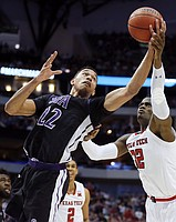Stephen F. Austin forward TJ Holyfield (22) and Texas Tech forward Norense Odiase (32) battle for a rebound during the first half of a first-round game at the NCAA college basketball tournament in Dallas, Thursday, March 15, 2018. (AP Photo/Brandon Wade)