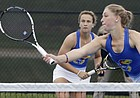 Kansas No. 1 doubles players Janet Koch, left, watches her teammate, Nina Khmelnitckaia, return a volley at the net during their NCAA Tournament doubles match against Denver on Friday, May 3, 2019, at Jayhawk Tennis Center at Rock Chalk Park. The Jayhawks defeated Denver 4-0 to advance to play Florida in Round 2.