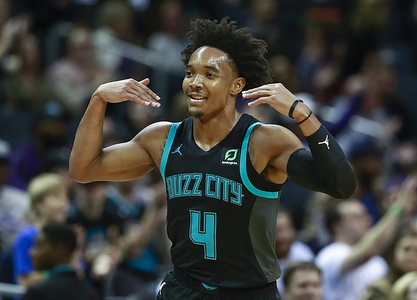 Charlotte Hornets guard Devonte' Graham gestures after making a 3-point basket during the second half of an NBA basketball game against the Orlando Magic on Monday, Dec. 31, 2018, in Charlotte, N.C. The Hornets won 125-100. (AP Photo/Jason E. Miczek)